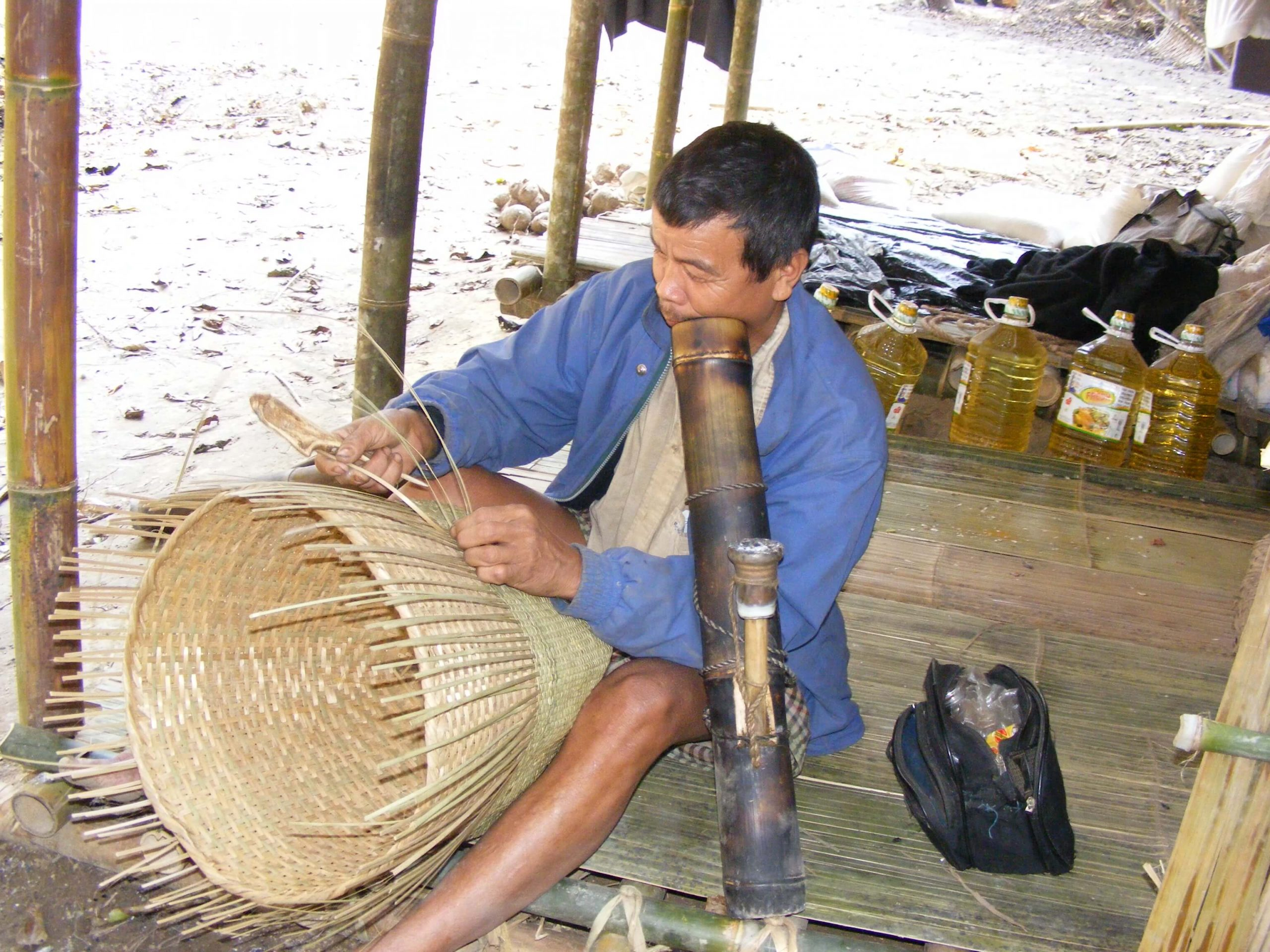 Indigenous man weave traditional equipment